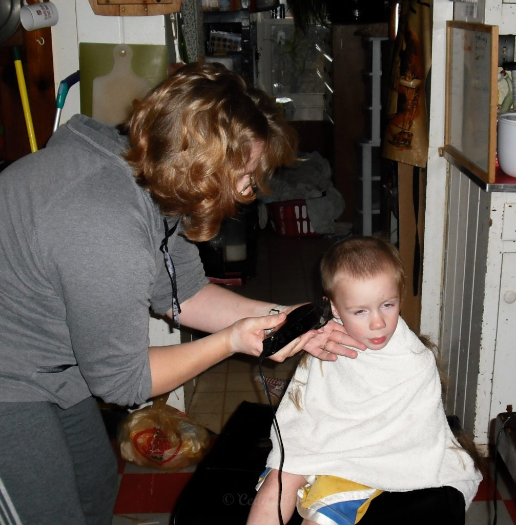 Mama cutting Johann's hair